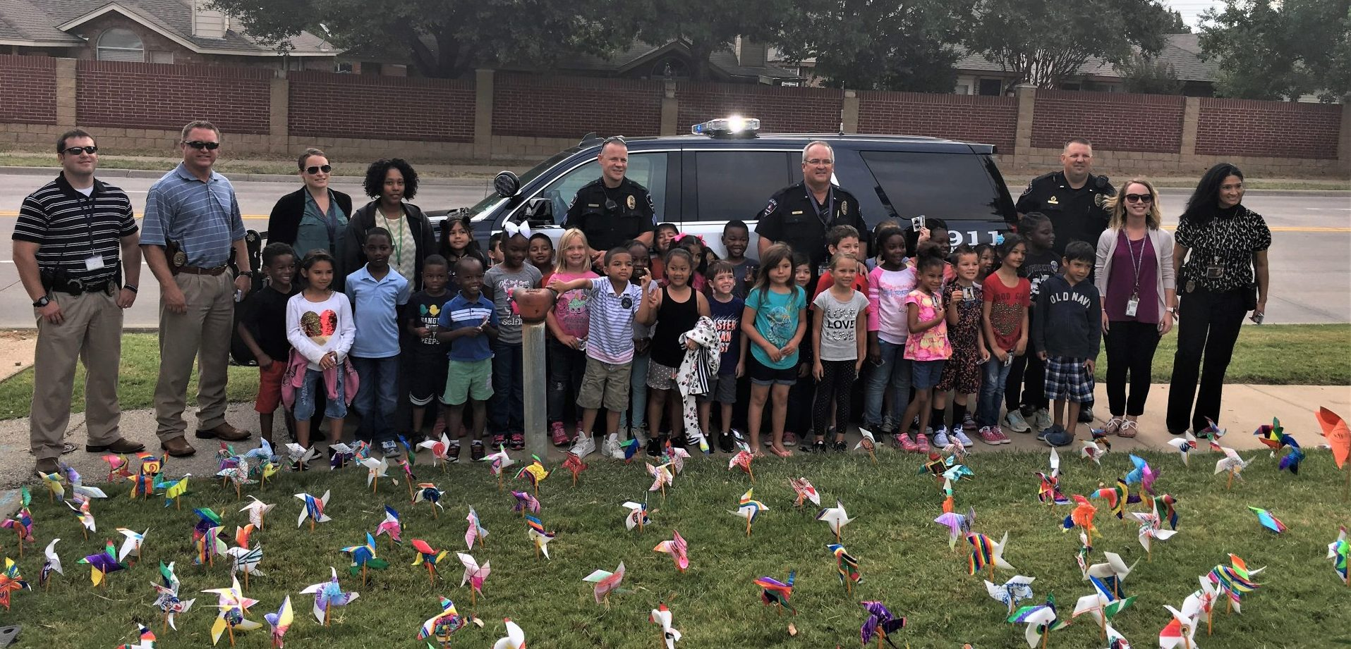 The Arlington PD joins Ashworth for Pinwheels for Peace 2017
