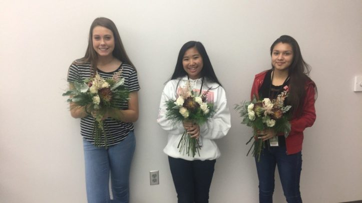 Floral Design students holding their bouquets.